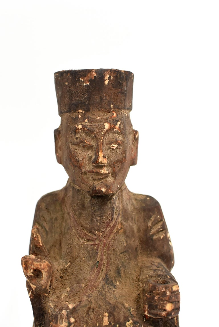 Very old solid wood statue depicts the Taoist Zen Master. He wears typical Tao robe and hat, with two fingers pointing up, and the left hand on his knee. Such a mudra symbolizes the connection of heaven and earth which is consistent with the Taoist