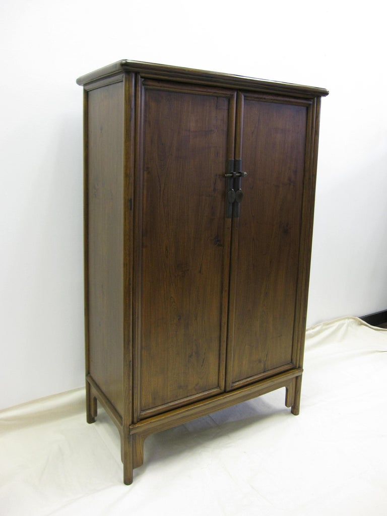 Antique Chinese tapered cabinet. Solid elm wood with round corner details, tapering 33 at the top to 34 at the bottom. Classic Chinese tenon and mortise joinery. Two drawers inside with a top shelf of 13.5 H, middle shelf 12.5 H and lower shelf 13.5
