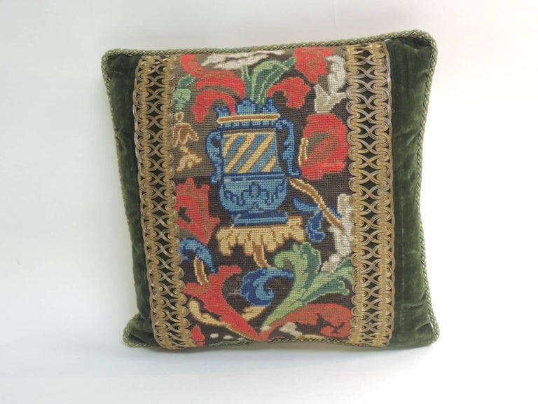 One-of-the-kind: 19th century needlepoint colorful tapestry in the center of the pillow. Decorative one-of-a-kind pillow embellished with a 19th century metallic woven gold trim. Decorative pillow antique textile framed with 18th century hunter