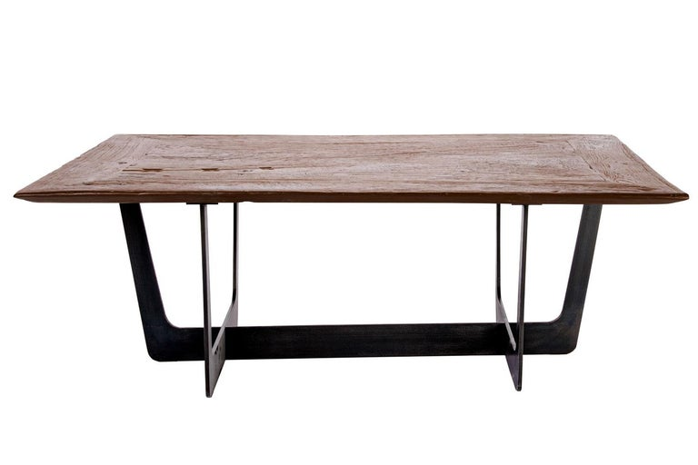 Teak top with custom iron base coffee table  This teak coffee table adds a beautiful and versatile layer into a variety of interior setting. With a generous surface area, it pairs well with modern, large sectionals. The tabletop is a re-purposed