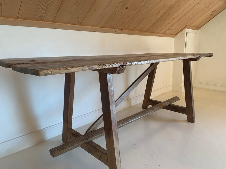 A 19th century pine trestle table with a two plank top. Pyrinee region, Spain.