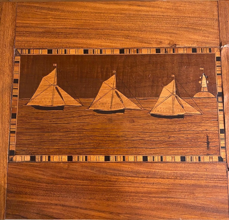 Fine 19th century trinity house marquetry inlaid rosewood sewing box, circa 1870, made by a Trinity House Lighthouse Keeper or sailor aboard a Lightship for sale to passing ships. The rosewood box features marquetry inlaid cutter-rigged sloops