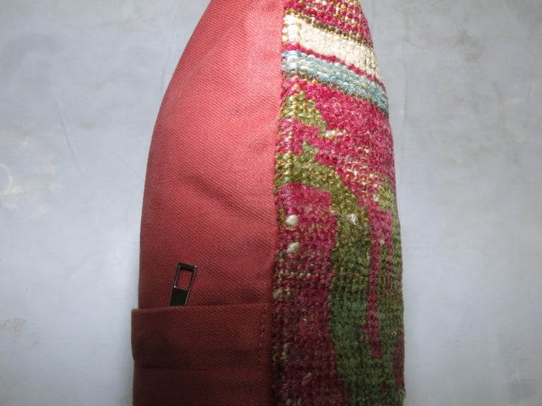 One of a kind rug pillow made from a vintage Turkish Oushak with cotton back and zipper closure.