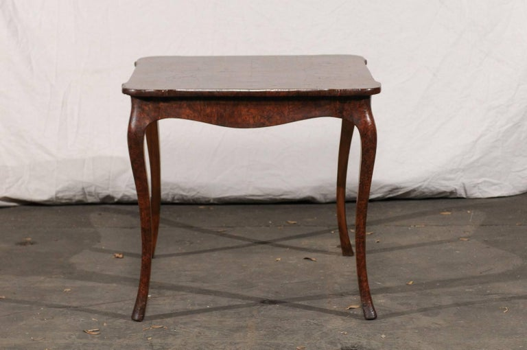 19thcentury turn of the century Continental burl wood card table.