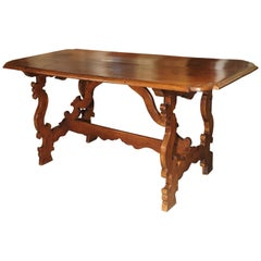 19th Century Tuscan Walnut Table with Shaped Wooden Stretchers