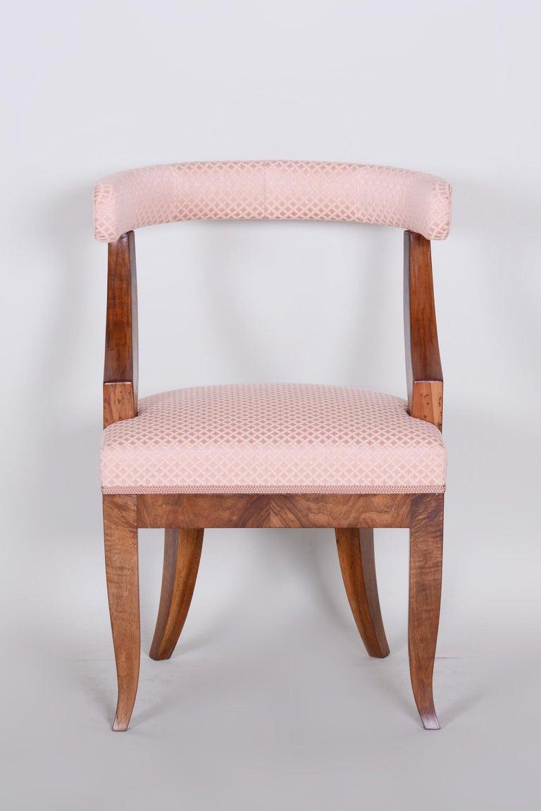 Biedermeier armchair Material: Walnut. Source: Austria, Vienna Period: 1820-1829  Completely restored. New professional upholstery. Shellac-polish.