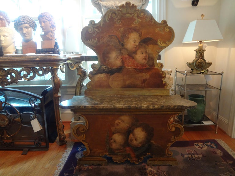Stunning antique Venetian Baroque style carved and painted bench with a tall scrolled back and a scrolled lower frame. This lovely 19th century Venetian bench is painted with putti or angels on both the upper and lower portion. The bench on this
