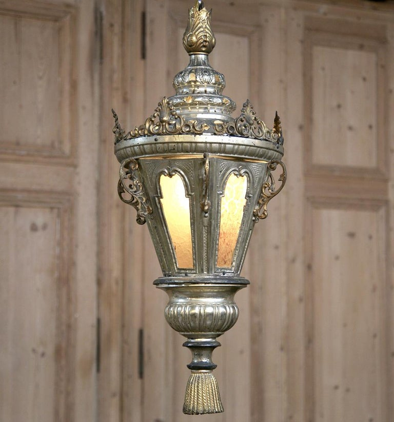 19th century Venetian silvered brass lantern chandelier was originally designed for a large pillar candle. We have now converted it to electric lighting so you get the best of both worlds ~ Old World ambiance, craftsmanship and style melded with