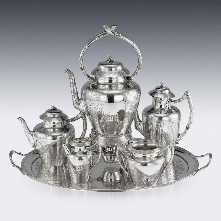 Antique 19th century Victorian Aesthetic movement solid silver tea and coffee service, comprising of a hot water kettle, coffee pot, teapot, sugar bowl, cream jug and tray. The set is extremely unusual and rare in design and finely crafted, engraved