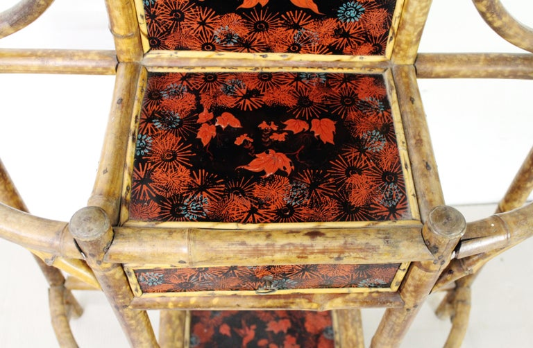 A lovely decorative late Victorian period bamboo hall stand. Of ornate style and appearance. Decorated with lacquered panels which are in very good order. With hooks for hanging coats (or hats) a small central drawer (useful for keys) and a mirror ,