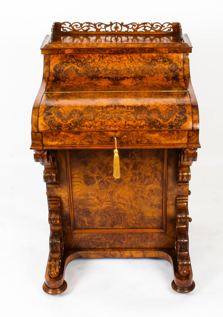 This is a gorgeous antique piano front Davenport Desk, circa 1860 in date.