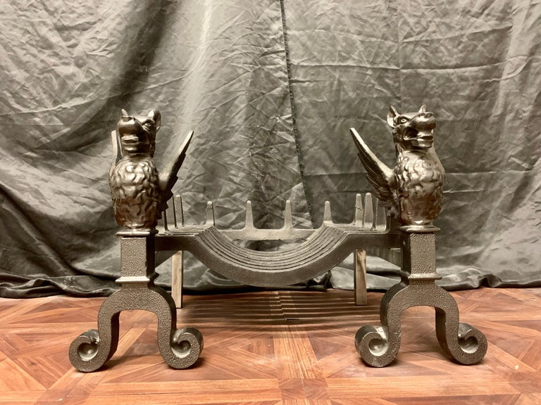 A small 19th century Victorian cast iron fire grate, with a pair of scrolled based griffins hosting the 'Swans Nest' shaped fire grate. The significance of the mythological Griffin creature stems from Greek Mythology-the beast being half lion, half