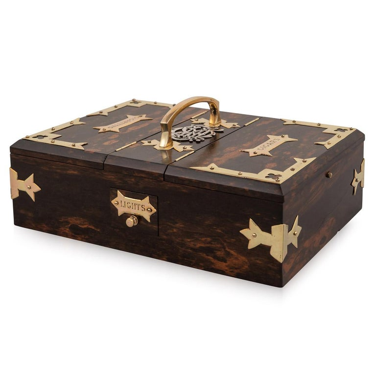Antique late-19th century Victorian coromandel wood smoker's box with polished brass mounts, two top drawers for cigarettes and cigars and two hinged doors on opposite sides for lights (matches), impressed reg no.22563 to base. A superb gift and a