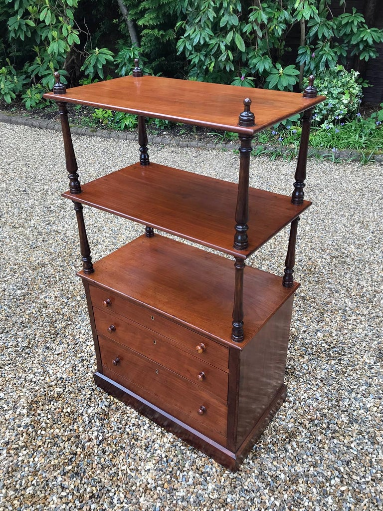 A very high quality 19th Century Victorian Mahogany Whatnot with 3 open shelves raised on turned columns and 3 mahogany lined drawers on plinth base and castors.