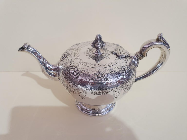 A fine and impressive antique Victorian Scottish sterling silver teapot.