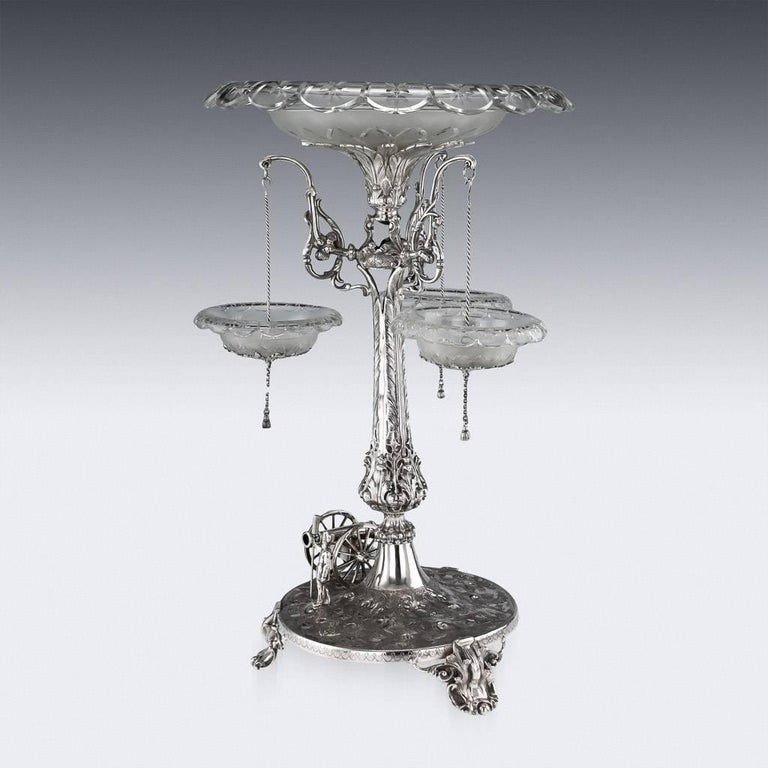 Antique 19th century Victorian impressively large and one of a kind regimental royal artillery centrepiece, the uplifted leaf shaped central column terminating with a flared foliate cut glass bowl, sides applied with three cast branches, each