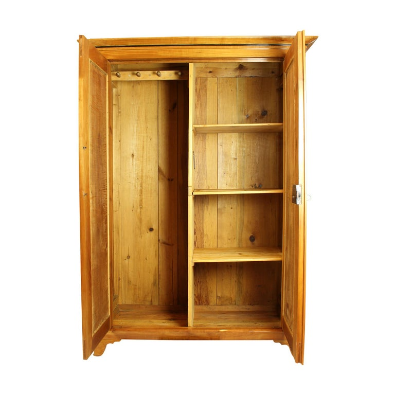 Beautiful wardrobe from the time of the Biedermeier circa 1840. Made of solid cherrywood. The wardrobe was lovingly restored by us. The wardrobe can be dismantled and shipped dismantled. An illustrated guide for the construction is enclosed. The