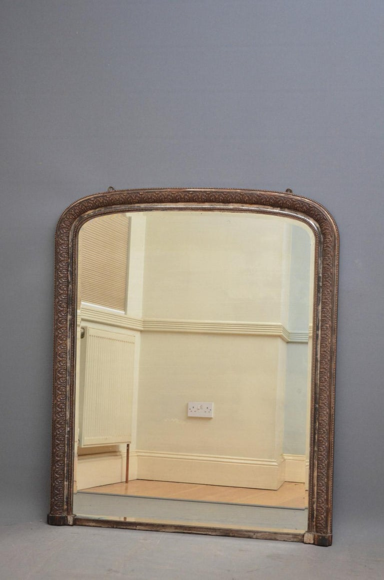 Sn4557, stylish 19th century overmantel mirror, having original bevelled edge and foxed mirror plate in acanthus leaf carved frame. 
