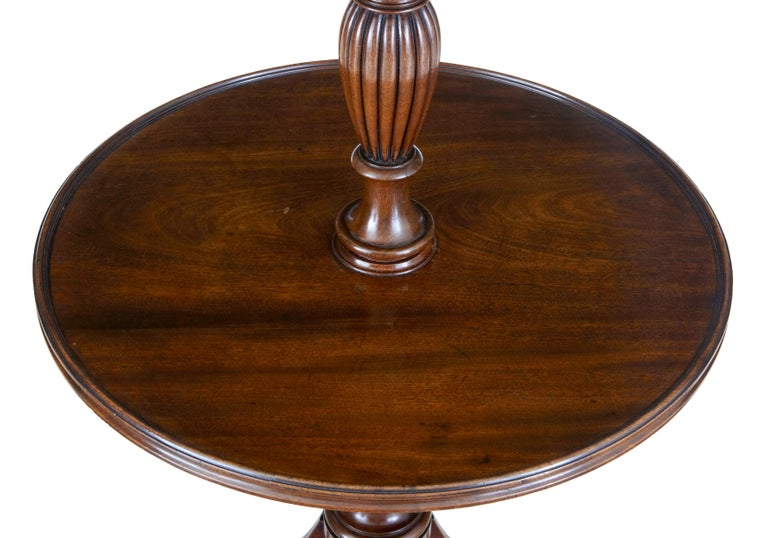 19th century William IV mahogany 2-tier dumb waiter, circa 1830.  Good quality 2-tier dumb waiter with 2 circular surfaces with moulded edge. Tiers united by a turned columns with fluted detailing. Standing on 3 reeded legs with brass