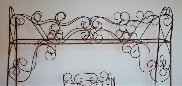 19th century wirework jardinière scrolled end supports with upper and one lower tray, untouched and in totally original condition.