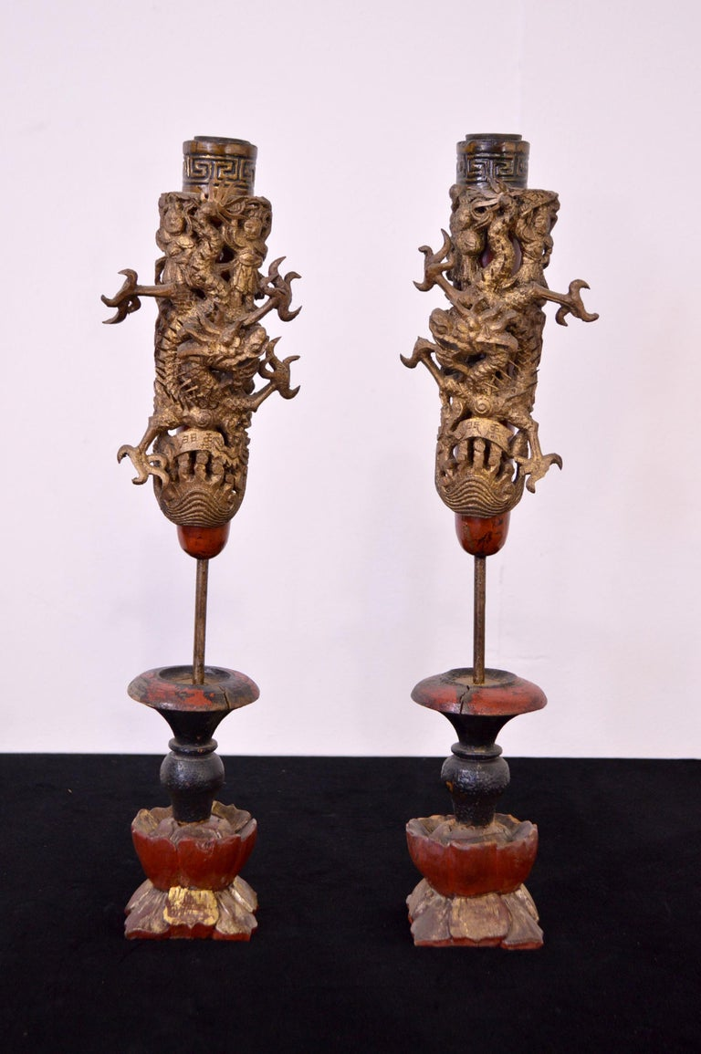Pair of light wooden candleholders hand-carved.