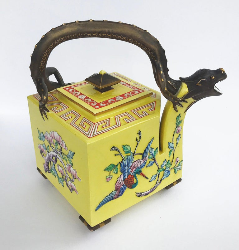 An excellent quality Worcester Royal porcelain works porcelain Aesthetic Movement teapots, circa 1875 Designed by James Hadley, Designed as a square sectioned body decorated with polychrome enameled Japanese style birds and blossoms all against an