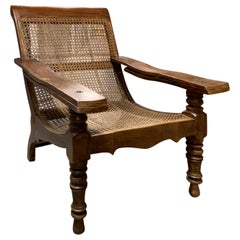 19th-Early 20th Century Anglo-Caribbean Caned Planters Chair with Leg Stretchers