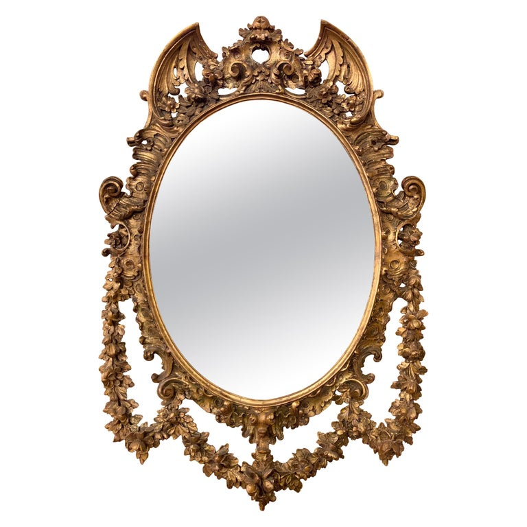 19th Early 20th Century Carved Oval Giltwood Wall / Console Mirror For Sale