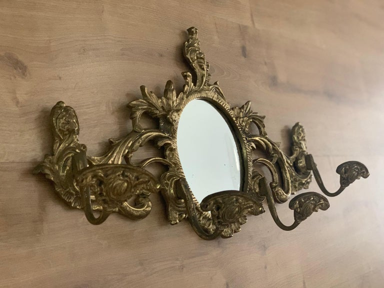 19th French bronze wall-mounted coat rack with mirror & four hangers.