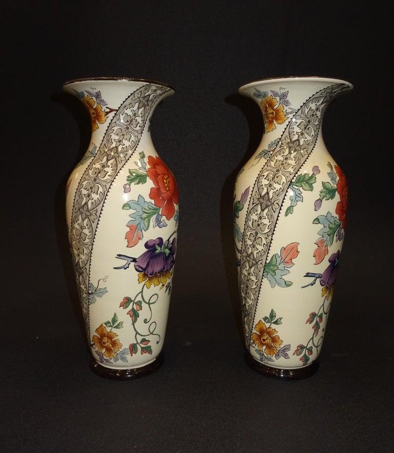 Outstanding pair of French ceramic vases with red and purple poppies and lace border as decoration, the manufacture is Gien, France (1875-1984), it was specialized in the elaboration of table and ornamental pieces as well as tiles, it has an