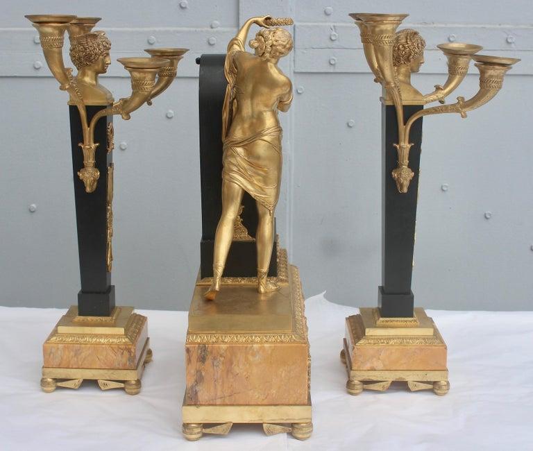 19th French Empire Ormolu and Patinated Bronze Three-Piece Clock Garniture 1