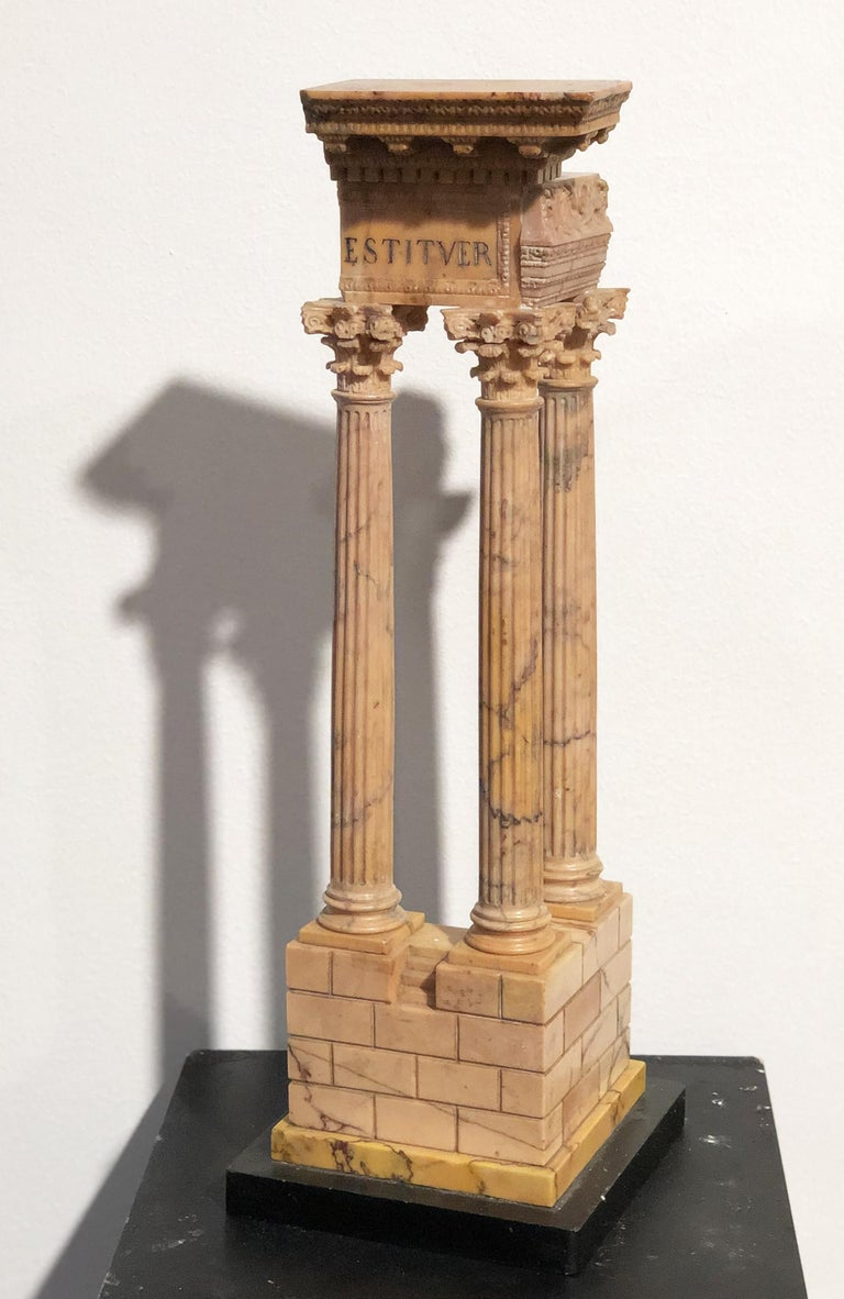 A superlative model of the temple of emperors Vespasiano and Tito made in a specimen and rare marble, the ancient yellow from Numidia. This is a very classical pieces of Grand Tour. The term