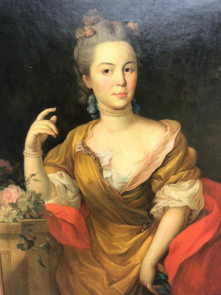 A refined 19th century Italian school painting representing a portrait of noble woman dressed in the fashion of the mid-18th century, oil on canvas with its original frame in the taste of the 18th century.  Canvas dimensions: Height 102 cm, length