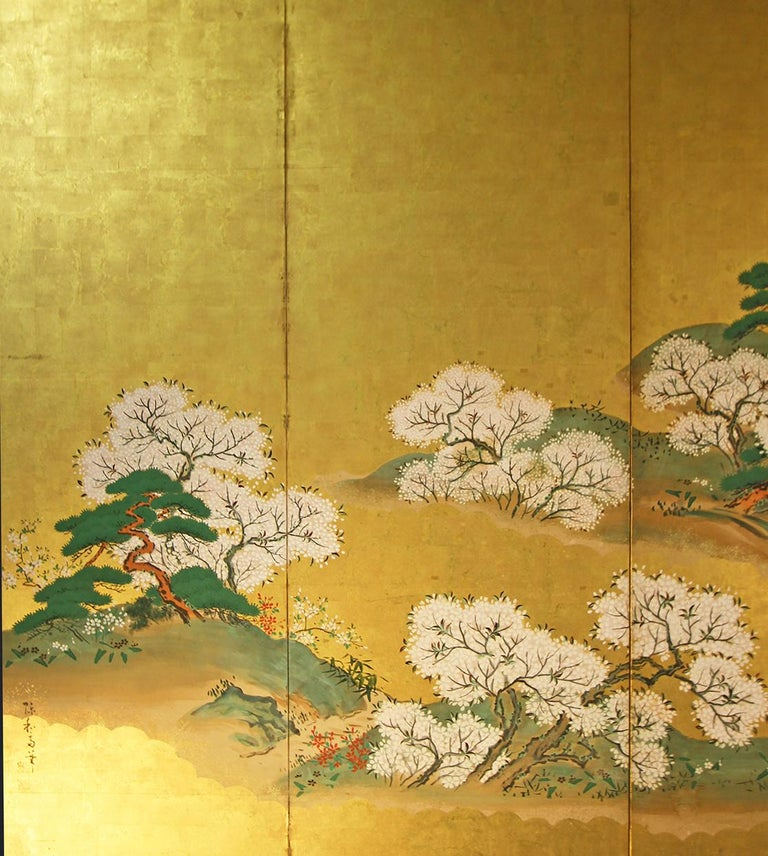 Landscape with flowering sakura trees of the early Meiji period. Six-panel screen painted with mineral pigments and inks on gold leaf from the Rinpa School.