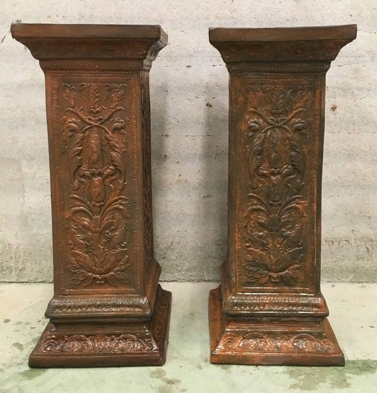 Spectacular 19th pair of columns or pedestals in glazed handmade terracotta.