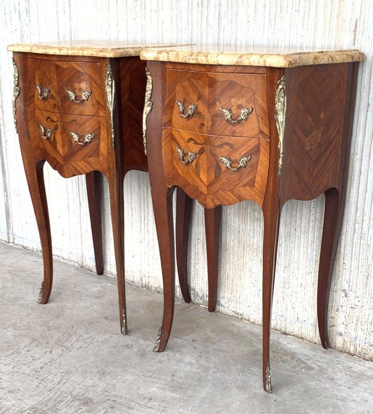19th Lovely Pair of French Marquetry Nightstands with Roses and Marble Tops Pair of beautiful French marquetry marble-top commode nightstands with bronze ormolu mounts and original beautifully veined contoured and beveled marble tops. Fine veneering