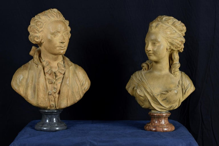 Pair of terracotta French busts resting on circular marble bases, 19th century, signed on the back.
