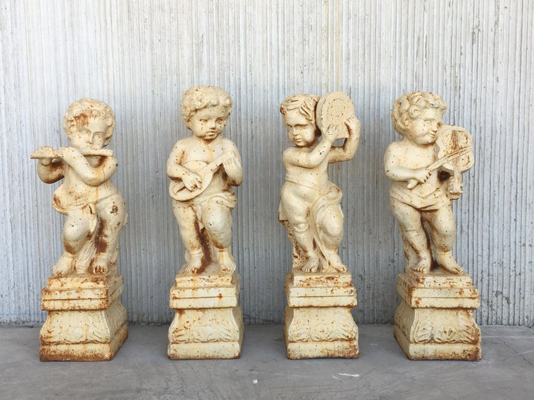 Neoclassical Revival 19th Set of Four Cast Iron Fiske Cherubs Boy Garden Statues with Stands For Sale