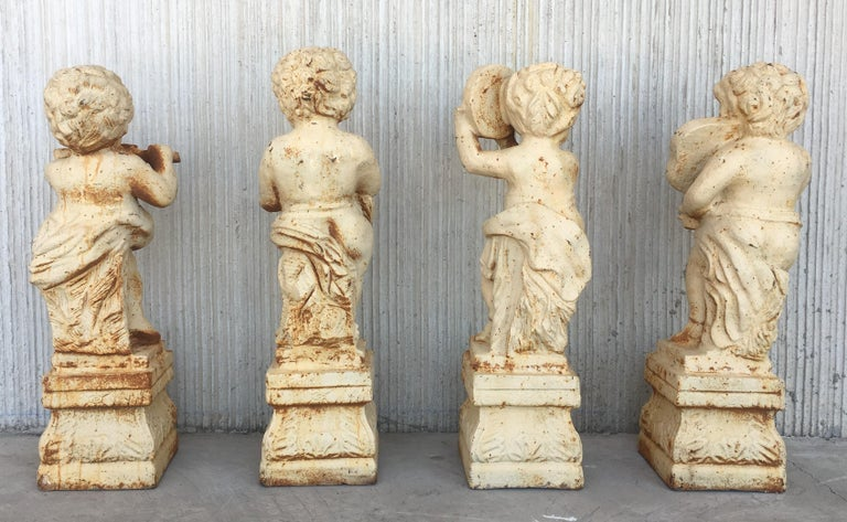 Italian 19th Set of Four Cast Iron Fiske Cherubs Boy Garden Statues with Stands For Sale