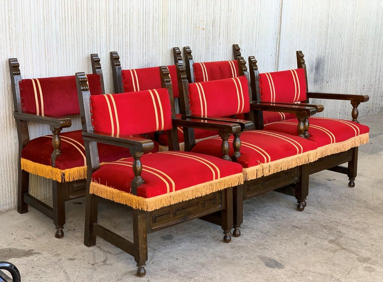 19th century set of six Spanish low armchairs in carved walnut and red velvet upholstery decorated with yellow fringes.   Arm Height: 24.6in