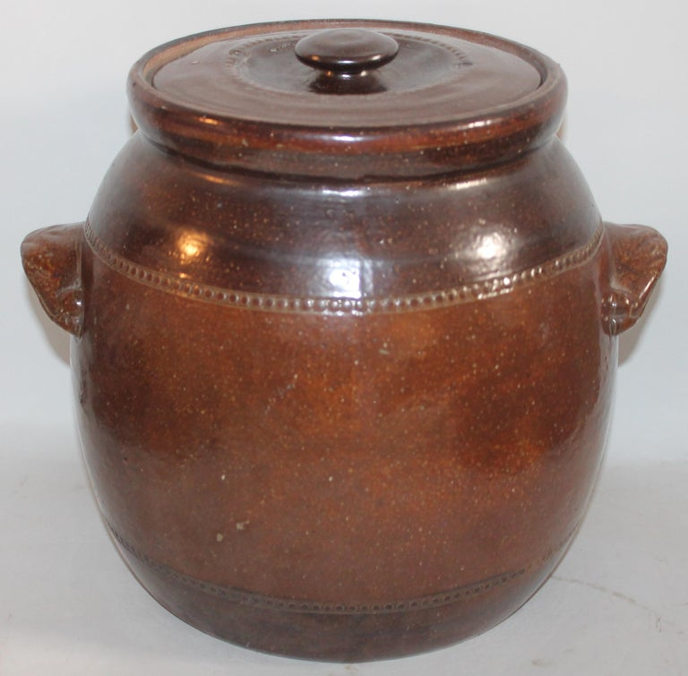This 19th century handmade pottery very large bean pot is in great condition and has a wonder aged patina glaze.