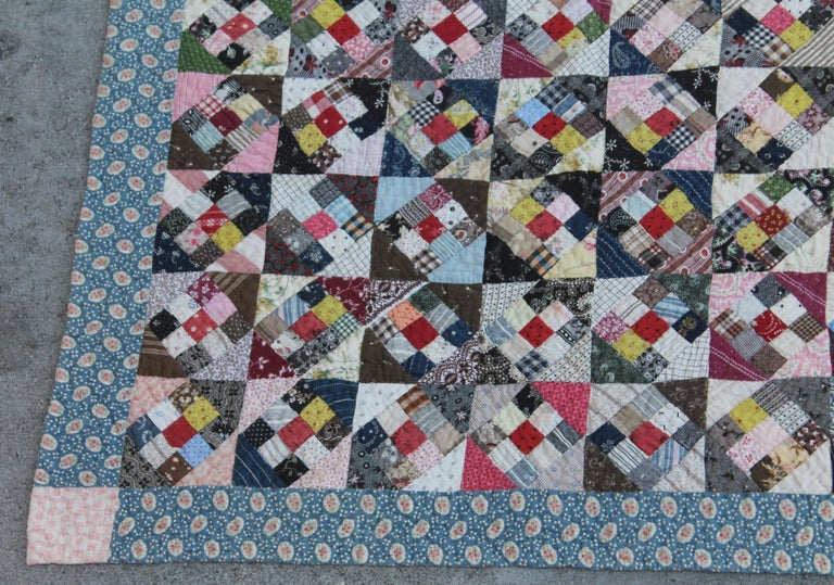 This tiny postage stamp nine patch in a square quilt was found in Pennsylvania and is in very good condition. The back is a bars pattern in calico fabric.