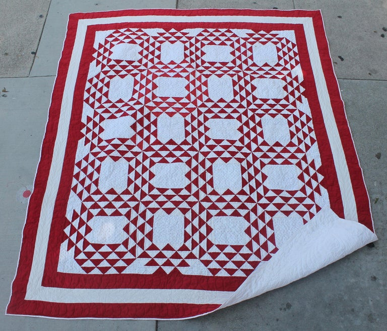 This fine early example of tight piece work and fine quilting is great condition. This ocean waves pattern quit has old calico shirting fabric in the back round of the quilt. This quilt was found in Pennsylvania.