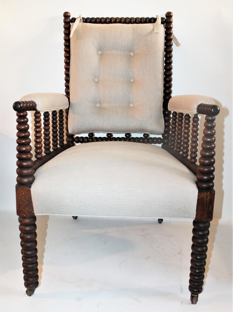 This 19th century Barley twist spool side chair is in fine condition and has a removable back cushion in linen. This chair is done in a fine thick cotton linen fabric and freshly upholstered. This chair is super comfortable.