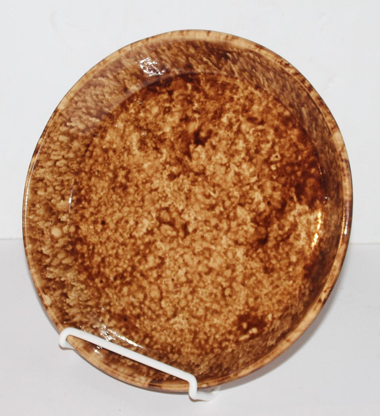 This 19th century Rockingham or Bennington sponge pie plate is in pristine condition and very large in size. These large pie plates are very hard to find.