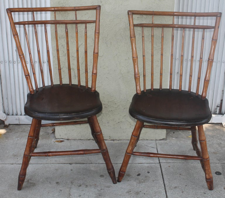 These amazing bamboo turnings Windsor chairs were found in Pennsylvania and are in fine sturdy condition. Fantastic plank seats and wonderful aged patina. All peg and early cut nail construction.