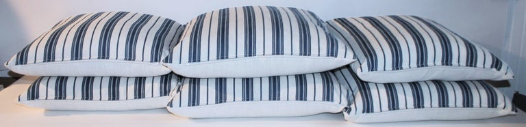 Fantastic 19Thc blue & white ticking pillows with white cotton linen backings. The inserts are down & feather fill. Two pairs in stock of 20 x 20 & two pairs of 22 x 22 in stock. Sold in pairs.
