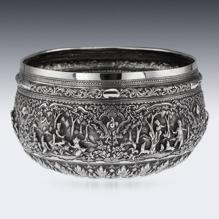 Antique late 19th century Burmese (Myanmar) solid silver repousse' bowl, repousse' decorated in high relief with scenes from the Burmese mythology, representing various figures and animals in a landscape, with very detailed scenes, the base