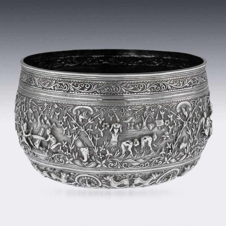 Antique late 19th century Burmese (Myanmar) outstanding solid silver repousse' bowl, repousse' decorated in high detail and relief with scenes of agriculture, villagers sailing, villagers sawing wood, transporting goods with two water buffalo,