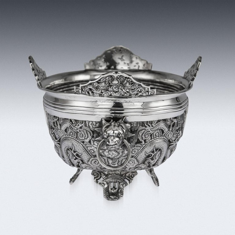 Antique late 19th century Chinese large solid silver jardinière, of oval form, applied with unusual twin dragon head handles with rings in mouth and standing on four coiled dragon feet, shaped top rim and sides decorated with pierced dragons amongst